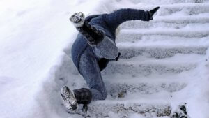a middle aged women was injured in a slip and fall accident on the icy steps in front of a Bronx NY business building.