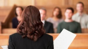 An attorney inside of a court room during the litigation of a personal injury case.