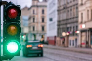 City lights can change quickly and if you are not paying attention as a driver or a pedestrian you could get hurt.