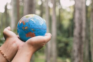 Hand Holding Earth Globe for Earth Day Concept